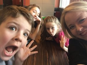 selfie with children at a table