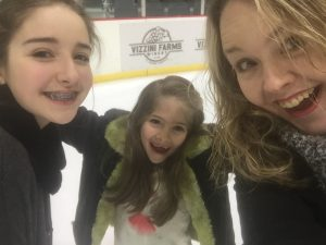 selfie with daughters at ice skating rink