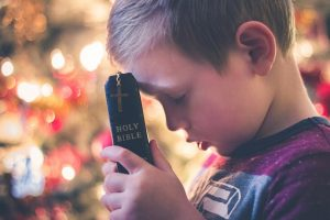 Boy praying with Bible - Just Ask - pixabay.com