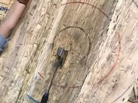 axe on wooden target